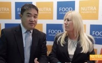 Weiguo Zhang, President of Synutra Pure, Ltd (left) and Jana Hildreth, Synutra's Director of Technology and Scientific Affairs, (right) speaking with NutraIngredients-USA at SupplySide West, November 2014