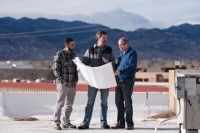Superior Ecotech's co-founders Daniel Higgs, right, and Phil Calabrese, left, discuss plans for the algae greenhouse with Upslope Brewery's founder Matt Cutter.